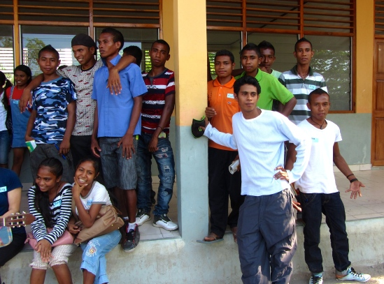 Some of the youth posing for a class photo before heading down to the sea for an afternoon of games and snacks.